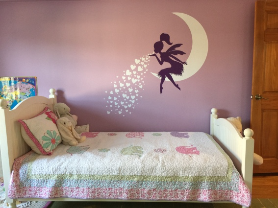 Fairy blowing hearts wall decal from Etsy