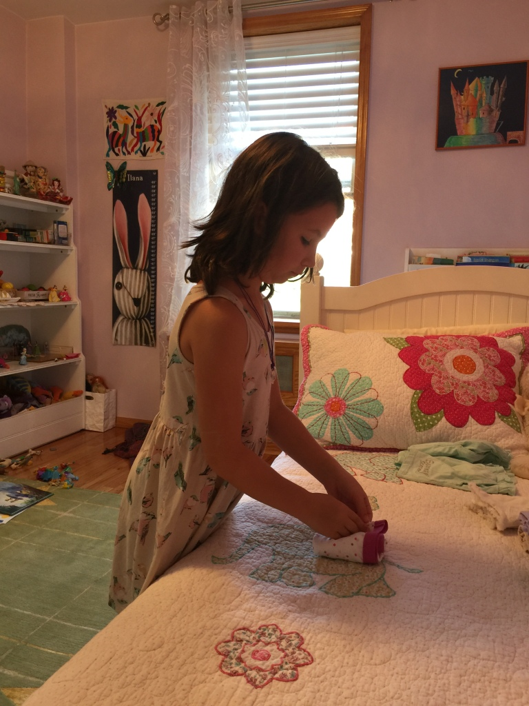Little girl folding her underwear